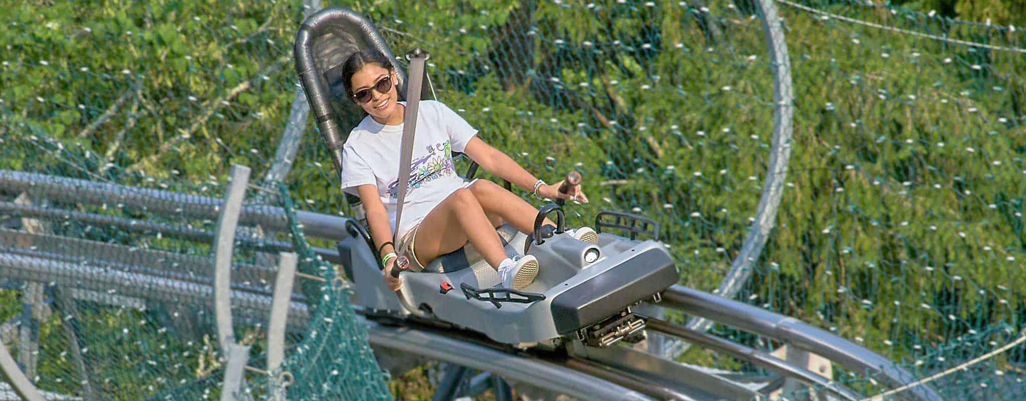 Couple riding Alpine Coaster