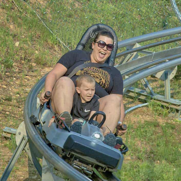 Dad and son on Alpine Coaster